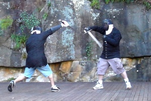 'En garde!' - Tim is on the left in authentic blue shorts