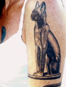 Bast — Egyptian goddess and protector of felines, adoring Kim's arm